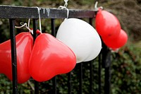 Heart_shaped balloons at a fence