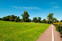 English suburban town park open space with pedestrian and bicycle lane, UK