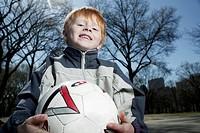 Boy Holding Soccer