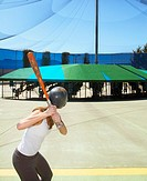 Woman in Batting Cage