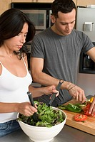 Couple Making Salad in Kitchen