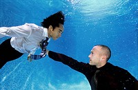 Two Young Businessmen Under Water