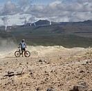 Mountain Biker in Volcanic Landscape