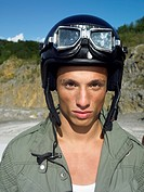 Young Man Wearing Helmet and Goggles
