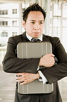 Businessman Clutching Briefcase