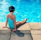 Girl Sitting at Edge of Swimming Pool