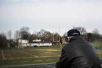Senior Man Looking at Football Field