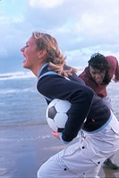 Couple on Beach Playing with Soccer Ball