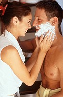 Woman Applying Shaving Cream on Her Boyfriend