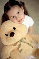 Young Girl with Her Stuffed Animal