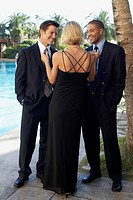 Blond Woman Flirting with Two Men