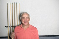 Senior Man Holding Pool Cue