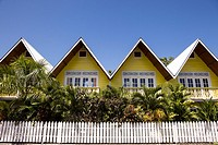 Vibrant yellow hotel on Isla Colon, Bocas del Toro, Panama