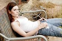 Woman Slouching on Rusty Chair