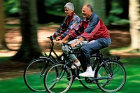 Senior Couple Cycling in Park, Summer