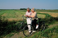 Senior Couple on Cycle Journey and Reading Map, Summer