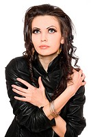 Portrait of charming young brunette in black clothes