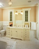 Residential bathroom with antique furnishings painted cream