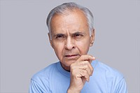 Close_up of elderly man thinking
