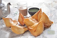 Fresh samosas with chutney and hot chai ready for breakfast