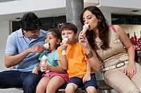 Family having great time together while eating ice cream