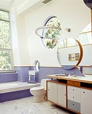 Bathroom with Formica countertop and porthole windows