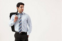 Young businessman with hand in pocket looking away