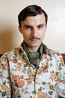Serious Man Wearing Floral Shirt and Cravat