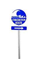 Sign pointing towards the tsunami evacuation route, includes clipping path
