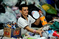 Young man sorting recyclables, the medium-sized company of a women's organisation separating rubbish and selling the resouces to the industry, Escazu,...