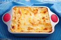 classic lasagna over blue cloth
