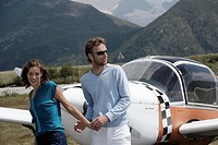 Young Couple Taking a Private Plane
