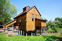Old wooden house, mill on the banks of the Maly Dunaj river in Slovakia