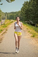 young woman jogging in a park