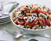 Fusilli pasta with olives, feta cheese, dill, tomatoes, cucumber and chickpeas