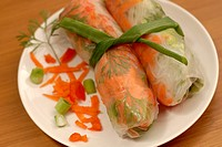 Vietnamese style Spring Rolls, garnished and tied together with a green onion  Vegetarian and Vegan appetizer