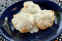 Homemade drop biscuits covered in country style milk gravy and pepper  Lacto Ovo vegetarian
