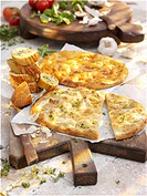 Various types of gratinated unleavened bread and garlic baguette
