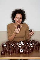 Woman Eating Chocolate Covered Marshmallows