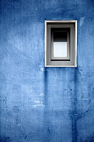blue wall with a window