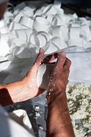 Raw milk sheep´s cheese being kneaded by hand and placed in moulds Portugal