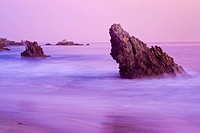 USA, California, Orange County, City of Newport Beach, Corona del Mar Beach, Sea stack at twilight
