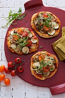 Mini pizzas topped with grilled vegetables