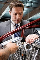 Businessman Working on Motorcycle
