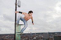 Man on Top of Pole