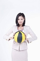 A woman holding the basketball
