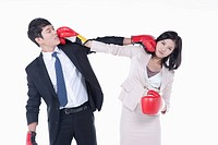A man and woman punching on each other