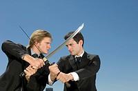 Businessman in Sword Fight