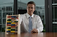 Businessman Using Abacus