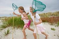 Girls with Nets Running on Beach